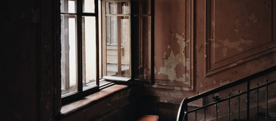 black-and-brown-stairs-beside-window-3150918